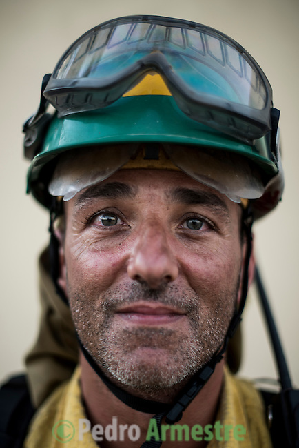 Miguel Rubio Galán. The firefighter from the BRICA Málaga 703, the Andalusian Service firefighting (INFOCA),  posses after a wildfire in Los Barrios near Cadiz on July 25, 2015. © Pedro ARMESTRE