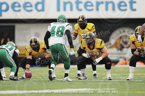 October 31, 2009; Hamilton, ON, CAN;  Hamilton Tiger-Cats offensive lineman Marwan Hage (62), offensive lineman Peter Dyakowski (67), offensive lineman Alexandre Gauthier (66). CFL football: Saskatchewan Roughriders vs. Hamilton Tiger-Cats at Ivor Wynne Stadium. The Tiger-Cats defeated the Roughriders 24-6. Mandatory Credit: Ron Scheffler. Copyright (c) 2009 Ron Scheffler.