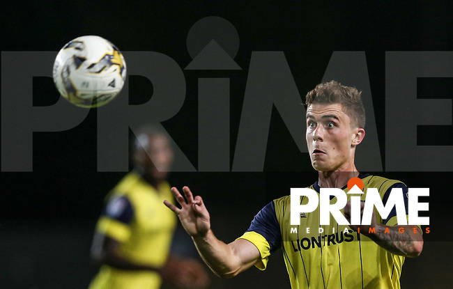 Josh Ruffels of Oxford United keeps eyes on the ball during the The Checkatrade Trophy match between Oxford United and Exeter City at the Kassam Stadium, Oxford, England on 30 August 2016. Photo by Andy Rowland / PRiME Media Images.
