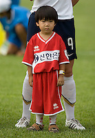 Korean boy. The USWNT defeated, 2-0, at the Suwon Sports Center in Suwon, South Korea.
