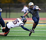 Althoff wide receiver Justin Strong (6, right) evades a tackle attempt by Carterville linebacker Colin Laczynski (35) in the first quarter. The Althoff Catholic High School Crusaders defeated the Carterville Lions 42-0 in a first-round Illinois High School Association Class 4A football playoff game on Saturday October 28, 2017 in Belleville.