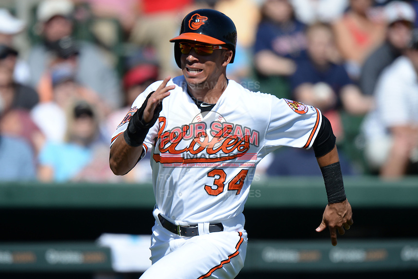 Baltimore Orioles outfielder Quintin Berry (34) during a spring training game against the Boston Red Sox on March 8, 2014 at Ed Smith Stadium in Sarasota, Florida.  Baltimore defeated Boston 7-3.  (Mike Janes/Four Seam Images)