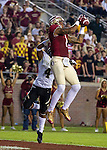 FSU wide receiver Kelvin Benjamin goes up for a touchdown reception over Idaho cornerback Jayshawn Jordon when the #2 ranked Florida State Seminoles defeated the Idaho Vandals 80-14 at Doak S Campbell Stadium in Tallahassee, Florida.
