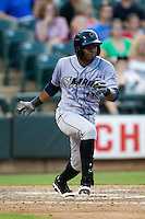 Omaha Storm Chasers shortstop Irving Falu #12 heads to first base during the Pacific Coast League baseball game against the Round Rock Express on July 22, 2012 at the Dell Diamond in Round Rock, Texas. The Express defeated the Chasers 8-7 in 11 innings. (Andrew Woolley/Four Seam Images).
