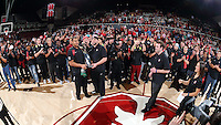 STANFORD, CA - December 16, 2015: Stanford Cardinal defeats Tennessee Lady Volunteers 69-55 at Maples Pavilion.  Stanford's Football team with the Pac-12 Championship Trophy.