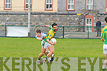 Paul Galvin of Finuge breaking away from Desmond's Sean Lynch.