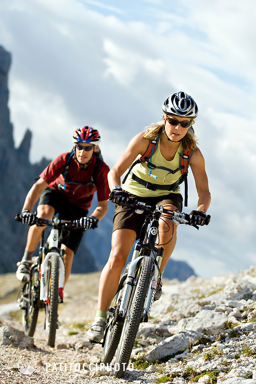 Klaus Fontana and Verena Kuen mountain biking in the Italian Dolomites