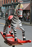 "A view of, ""Deebra at the Zoo"" by artist, Debra Ricks,one of the 35 Artist painted Rocking Horses on display around Saugerties, NY as part of the Chamber of Commerce sponsored Art in the Village Project titled ""Rockin' Around Saugerties."" This photo taken on Friday, May 26, 2017. Photo by Jim Peppler. Copyright/Jim Peppler-2017."