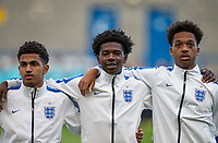 (l-r) Marcus Edwards (Tottenham Hotspur), Isaac Buckley-Ricketts (FC Twente (on loan from Manchester City) & Chris Willock (Benfica) of England U20 during the National Anthem during the International friendly match between England U20 and Netherlands U20 at New Bucks Head, Telford, England on 31 August 2017. Photo by Andy Rowland.