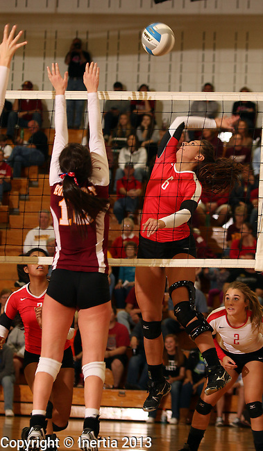 SIOUX FALLS, SD - OCTOBER 25:  Emily Herrera #6 from Rapid City Central looks for a kill attempt past Erinn Temple #16 from Roosevelt in the second game of their match Friday night at Roosevelt. (Photo by Dave Eggen/Inertia)