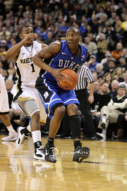 Duke Blue Devils guard Nolan Smith (2) looks to pass as Wake Forest Demon Deacons guard Tony Chennault (1) bears down on him. Duke wins 83-59..