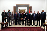 Palestinian President Mahmoud Abbas meets with a delegation from the doctors syndicate, in the West Bank city of Ramallah on September 30, 2018. Photo by Thaer Ganaim