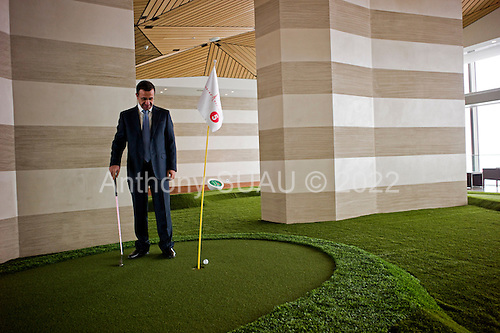Istanbul, Turkey<br /> March 9, 2011<br /> <br /> Kiler Holding Chairman Nahit Kiler plays gulf on the Sapphire's 40th floor golf course. Mr. Kiler is owner of the Sapphire building, a skyscraper, (the tallest building in Europe) located in Istanbul's Levent business district. It is a luxury shopping and residence mixed-use project by Biskon Construction (a subsidiary of the Kiler group of companies). Sapphire Istanbul offers a luxurious life style to owners as upper floor apartments sell for as high as $7,500,000 US.