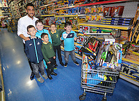 Pictured: Neil Taylor Wednesday 08 December 2016<br />Re: Swansea City FC players have bought Christmas gifts for 60 children at Smyths toy store in Swansea, south Wales.