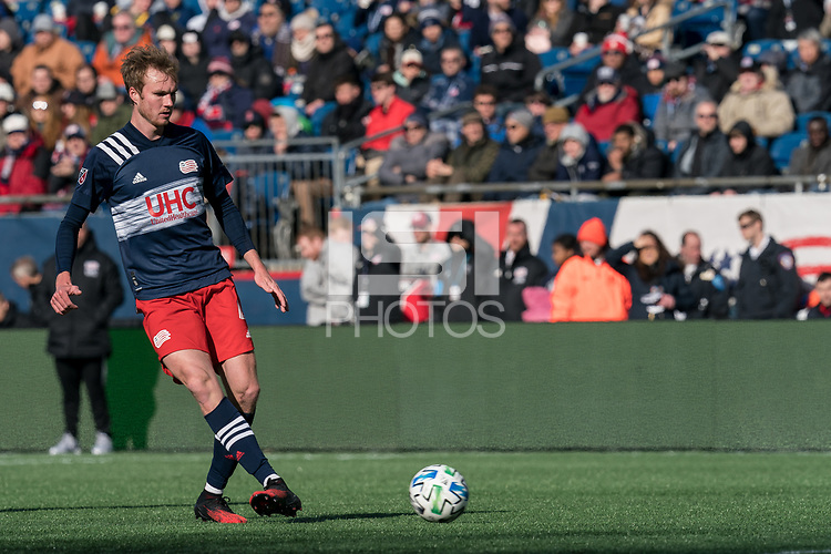 FOXBOROUGH, MA - MARCH 7: Henry Kessler #4 of New England Revolution passes back to goalkeeper during a game between Chicago Fire and New England Revolution at Gillette Stadium on March 7, 2020 in Foxborough, Massachusetts.