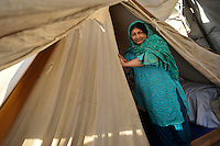 A refugee from Swat district in front of her tent at the Swabi Refugee camp. The camp is run by Red Cross/Red Crescent (ICRC), and currently houses around 18,000 refugees. The Pakistani government began an offensive against the Taliban in the Swat Valley in April 2009, which led to a major humanitarian crisis. Up to two million civilians were estimated to have been displaced by the fighting.