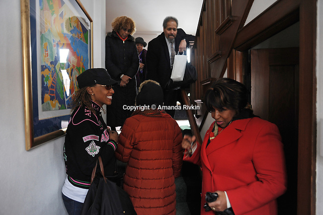 (Lower right) Candidate Carol Moseley Braun, a former U.S. Senator and Ambassador to New Zealand, is seen with friends and campaign workers in the foyer of her Hyde Park home before going to cast her ballot in the Chicago mayoral elections in Chicago, Illinois on February 22, 2011.