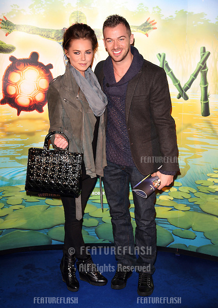 Kara Tointon and Artem Chigvintsev arriving for the gala premiere of Cirque Du Soleil's 'Totem' , at the Royal Albert Hall, London. 05/01/2011. Picture by: Alexandra Glen / Featureflash