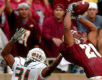 A Florida State receiver makes a catch in front of a Miami Hurricanes defensive back  Saturday October 11, 2003 in Tallahassee, Florida. (Rick Wilson/The Florida Times-Union)