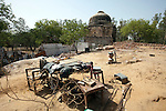 Squatters have recently been evicted and their homes bulldozed at the Bara Lao Ka Gumbad tomb in Basant Lok, Delhi. Some of the residents had lived on the site since 1943. Security guards now occupy the main tomb to  keep them from returning. The Archaeological Survey of India has been on a campaign to evict people who have illegally made ancient Mughal  tombs their homes throughout the city in recent times but is facing stiff opposition from the residents.