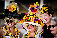 BALTIMORE, MD - MAY 19: Women pose as a friend takes a photo on Black-Eyed Susan Day at Pimlico Race Course on May 19, 2017 in Baltimore, Maryland.(Photo by Douglas DeFelice/Eclipse Sportswire/Getty Images)