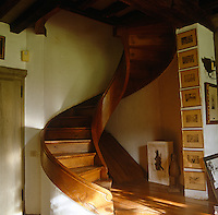 This wooden spiral staircase creates a sculptural focus in a corner of the room
