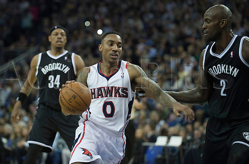 16.01.2014 London, England.  Atlanta Hawks' Guard Jeff Teague [0] drives for the basket during the NBA regular season game between the Atlanta Hawks and the Brooklyn Nets from the O2 Arena.