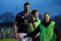 Neale Patrick of London Scottish Football Club comes off injured during the Greene King IPA Championship match between London Scottish Football Club and Ealing Trailfinders at Richmond Athletic Ground, Richmond, United Kingdom on 26 December 2015. Photo by Alan  Stanford / PRiME Media Images