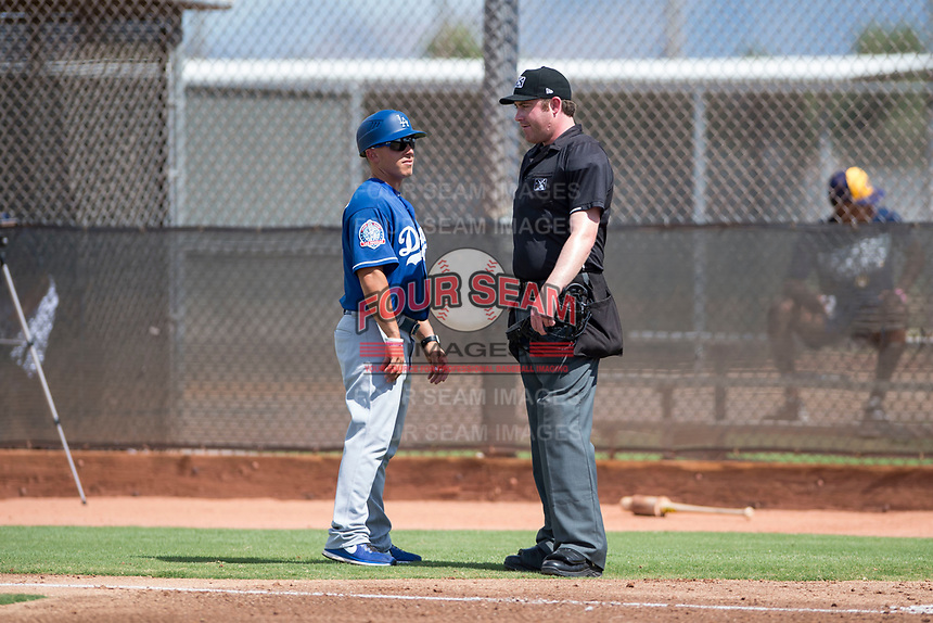 Los Angeles Dodgers coach Jeremy Rodriguez (17) talks to the home plate umpire during an Instructional League game against the Milwaukee Brewers at Maryvale Baseball Park on September 24, 2018 in Phoenix, Arizona. (Zachary Lucy/Four Seam Images)