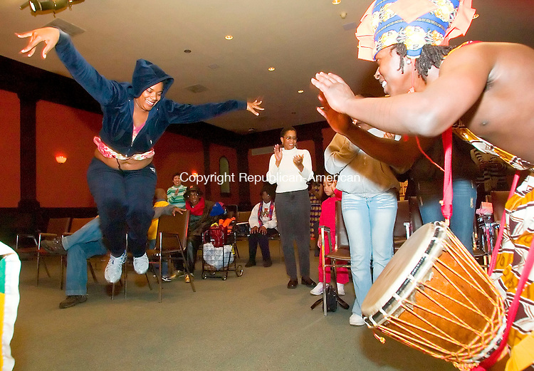 WATERBURY, CT- 30 DEC 06- 123006JT29- <br /> Francesca Fraser dances as Lucas Kumah drums towards the end of the Sounds of Afrika Kwanzaa performance at Mattatuck Museum in Waterbury on Saturday afternoon.<br /> Josalee Thrift Republican-American