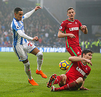 Huddersfield Town's Thomas Ince sees his shot blocked by Swansea City's Federico Fernandez<br /> <br /> Photographer Alex Dodd/CameraSport<br /> <br /> The Premier League - Huddersfield Town v Swansea City - Saturday 10th March 2018 - John Smith's Stadium - Huddersfield<br /> <br /> World Copyright &copy; 2018 CameraSport. All rights reserved. 43 Linden Ave. Countesthorpe. Leicester. England. LE8 5PG - Tel: +44 (0) 116 277 4147 - admin@camerasport.com - www.camerasport.com