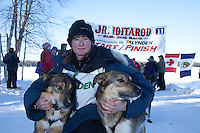 Anitra Winkler poses with her lead dogs at the finish of the 2011 Jr. Iditarod   Willow, Alaska