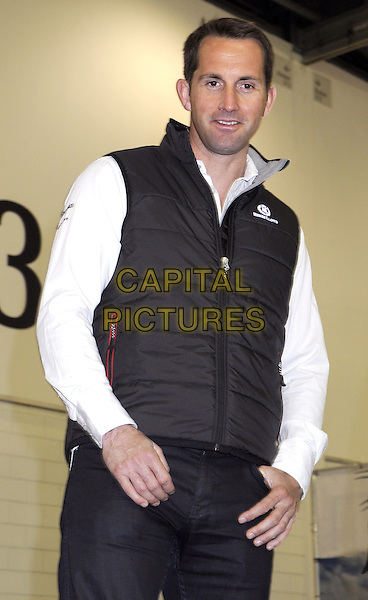Olympic Gold medallist Sir Ben Ainslie.At the Tullett Prebon London Boat Show Opening Day at the Excel Centre, London, England..January 12th 2012.half length white top black sleeveless puffa jacket vest .CAP/BK/PP.©Bob Kent/PP/Capital Pictures.