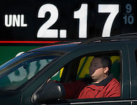 Drivers sit at a traffic signal near Powell, Ohio,where gasoline is advertised for almost $2 a gallon.<br />