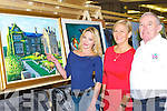 Killarney artist Egijan Venediktova shows Sheila Goulding, Con Brosnan, her beautiful painting of Muckross House at the Killarney Rotary Club annual Wine and Art night at the Malton Hotel on Thursday