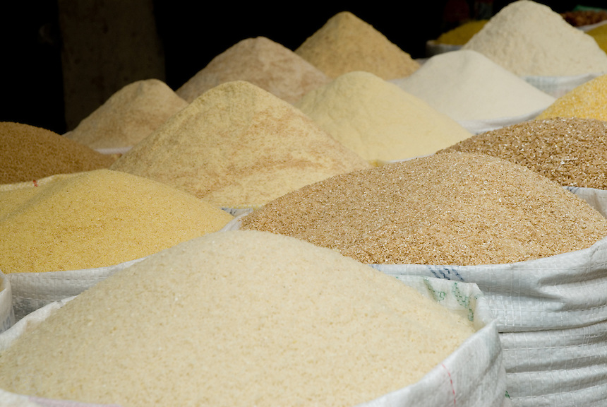 Dry grains, flours, and couscous for sale in the market in Fez, Morocco.