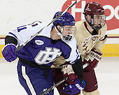 Jake Youso (HC - 11), Steven Santini (BC - 6) - The visiting College of the Holy Cross Crusaders defeated the Boston College Eagles 5-4 on Friday, November 29, 2013, at Kelley Rink in Conte Forum in Chestnut Hill, Massachusetts.