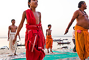 Young children training to be priests perform yoga on the ghats on river Ganges in the ancient city of Varanasi in Uttar Pradesh, India. Photograph: Sanjit Das/Panos