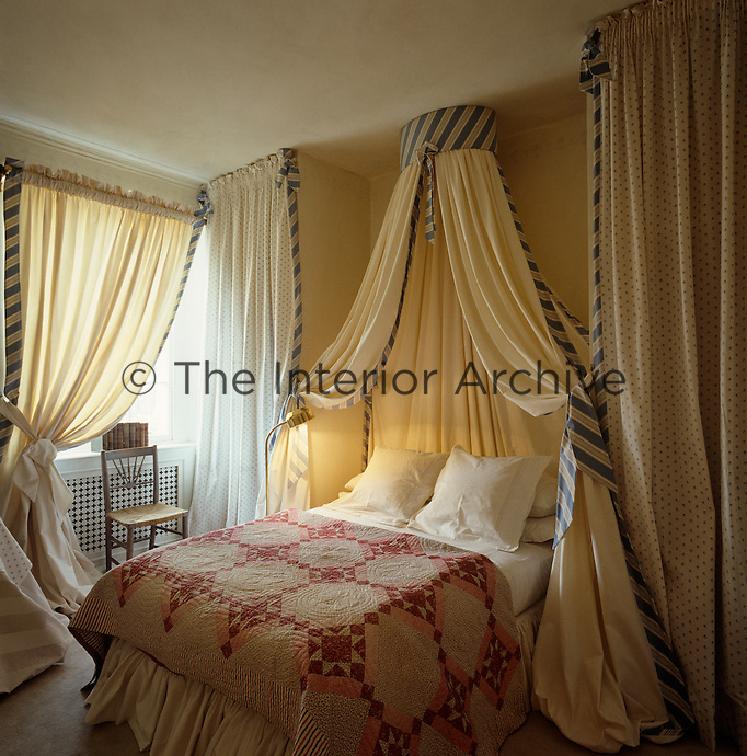 The use of curtains and drapes add drama and a sense of luxury to this bedroom