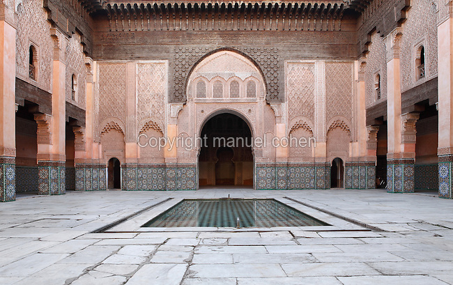 Main courtyard of Ben Youssef Madrasa, Medina, Marrakech, Morocco. The courtyard has a central pool for ablutions and its walls are intricately decorated with carved stucco and zellige tilework. The Madrasa is an Islamic theological college founded in the 14th century and rebuilt by the Saadians in the 1560s. It is named after the Almoravid Sultan Ali ibn Yusuf, who reigned 1106-42. Picture by Manuel Cohen