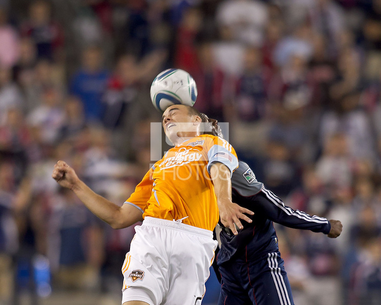 Houston Dynamo forward Cam Weaver (15) and New England Revolution midfielder Sainey Nyassi (17) battle for head ball. The New England Revolution defeated Houston Dynamo, 1-0, at Gillette Stadium on August 14, 2010.