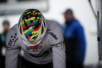 Mathieu Van der Poel (NLD/BKCP-Corendon) warming up for his very first appearance in the rainbow jersey in the 2015/2016 CX season showing a brand new world champ color scheme on top of his helmet<br /> <br /> Duinencross Koksijde WorldCup 2015