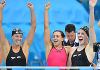 August 04, 2012..L to R: Dana Vollmer, Rebecca Soni, Missy Franklin react as Allison Schmitt smashes the world record to win Women's 4x100m Medley Relay at the Aquatics Center on day eight of 2012 Olympic Games in London, United Kingdom.