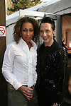 Law & Order SVU's Tamara Tunie (As The World Turns) & Johnny Weir at Skating with the Stars (celebrities & Olympic skaters), a benefit gala for Figure Skating in Harlem on April 6, 2010 at Wollman Rink, Central Park, New York City, New York. (Photo by Sue Coflin/Max Photos)