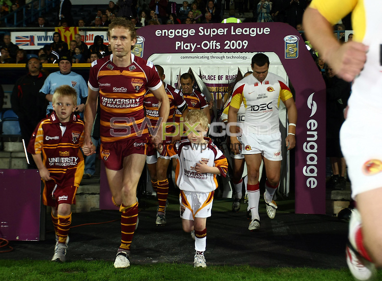 PICTURE BY VAUGHN RIDLEY/SWPIX.COM - Rugby League - Super League Playoffs - Huddersfield v Catalans - Galpharm Stadium, Huddersfield, England  - 25/09/09...Copyright - Simon Wilkinson - 07811267706...The teams run out onto the pitch.