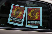 NEW YORK, NY - APRIL 24:  Banners displayed in cars as during a protest demanding to release ICE detainees in  due to Coronavirus on April 24, 2020 in New York City. Some people in cars and bicycles approached Governor Andrew Cuomo's office to demand the opening of ICE jails in New York State, as the governor has emergency powers to order the release of all ICE detainees.Photo by Pablo Monsalve / VIEWpress via Getty Images)