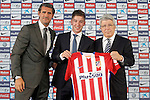 Atletico de Madrid's new player Luciano Vietto (c) with the President Enrique Cerezo (r) and the General Manager Jose Luis Perez Caminero (l) during his official presentation. July 9, 2015. (ALTERPHOTOS/Acero)