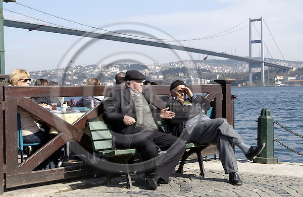 Istanbul-Turkey - 06 April 2006---Bridge in Ortaköy spans the Bosporus (Bosphorus, Bosphoros) and links Europe with Asia, two men observing the scene on the European side---transport, infrastructure, people---Photo: Horst Wagner/eup-images