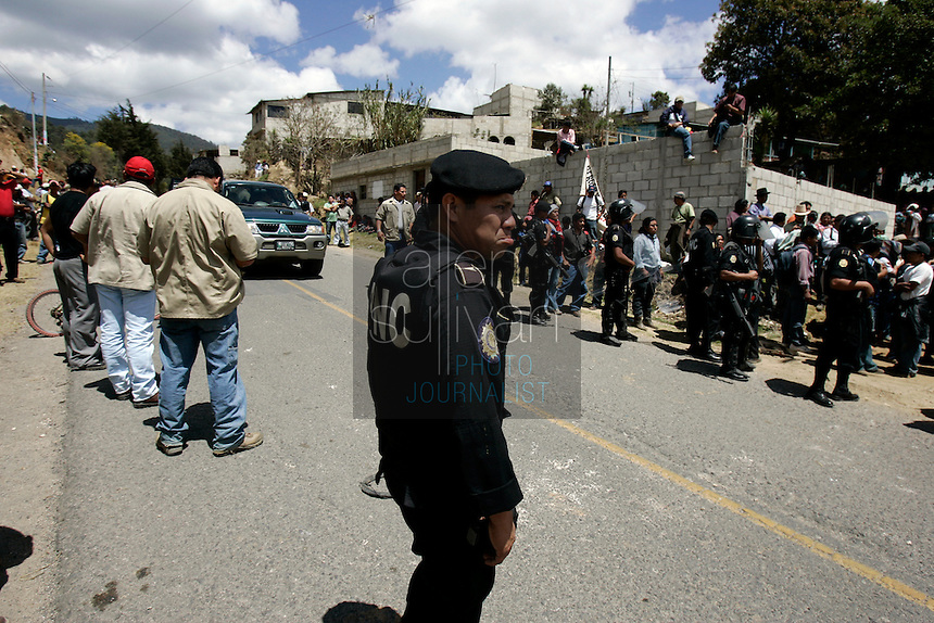 A police officer during a protest by indigenous people against U.S. President Bush in Tecpán Guatemala, Guatemala. Bush visited a nearby Mayan site, Iximché.