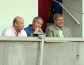 Washington, D.C. - July 4, 2007 -- United States President George W. Bush eats a hot dog as he watches the Chicago Cubs play the Washington Nationals at RFK Stadium in Washington on Thursday, July 7, 2007. With Bush, center, are Nationals President Stan Kasten, left, and Nationals General Manager Jim Bowden, right. <br /> Credit: Roger L. Wollenberg - Pool via CNP
